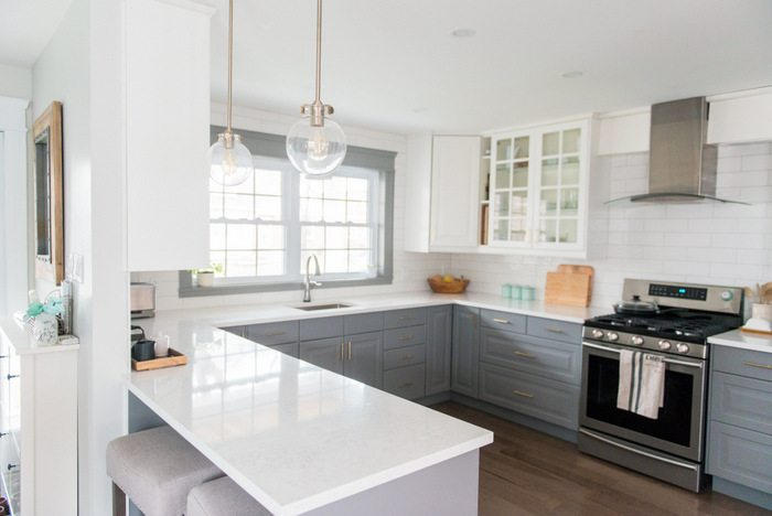 pristine white kitchen with quartz worktop