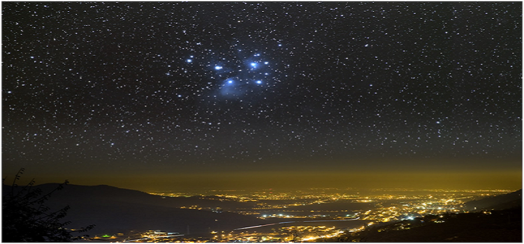 Universe above city lights courtesy of Marcel Clemens